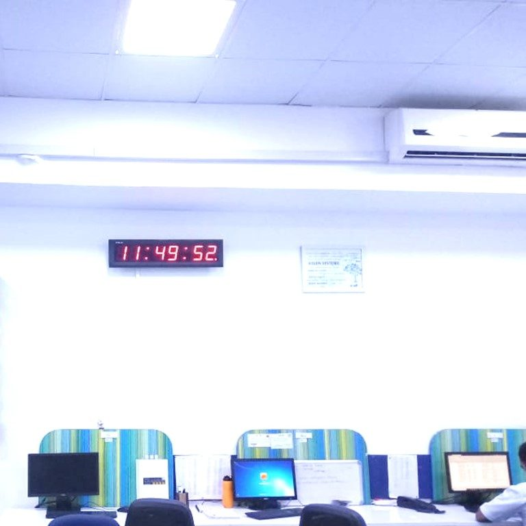 NTP Clocks by KritiKal - Network Time Protocol. This image shows an NTP Clock, which uses the Network Time Protocol, to be in sync; shown here in an office environment
